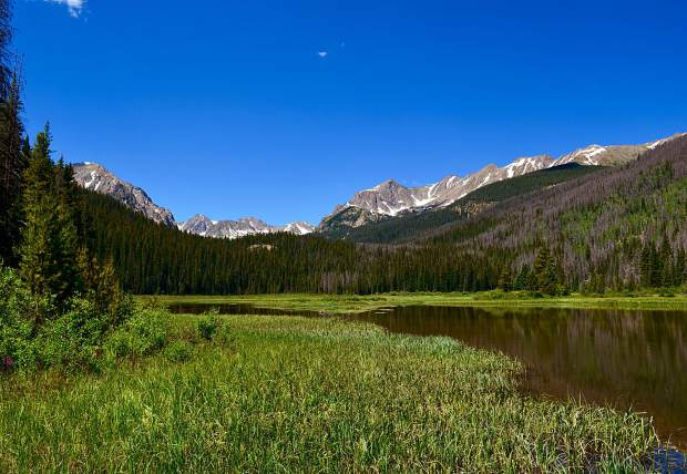 Stunning mountain views from the shores of Boulder Lake, an easy offshoot from the Gore Range Trail.
