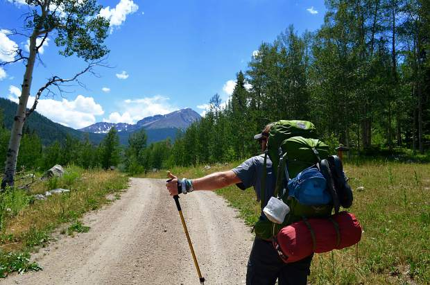 After hours of bushwhacking and stepping over logs, morale on the trail hit a low point when we contemplated thumbing a ride back to our car from the private road that passed by Black Lake Reservoir.