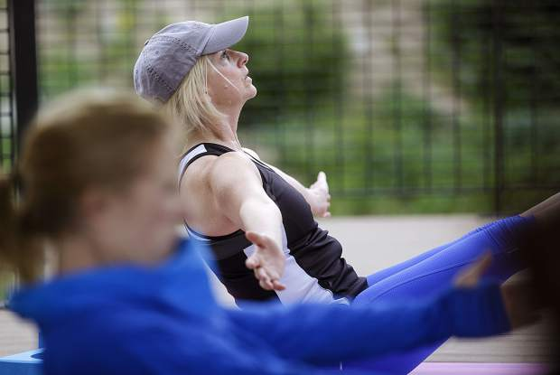 Jennifer Johnson hangs her balance while taking deep breaths during a yoga session Friday, July 21, at Arapahoe Basin Ski Area.