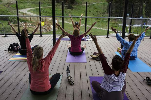 Summit County residents participate in a yoga session led by local instructor Sarah Schwartz Friday, July 21, at Arapahoe Basin Ski Area.