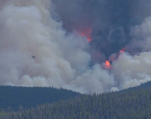 Helicopter charging towards Peak Two Fire July 5.