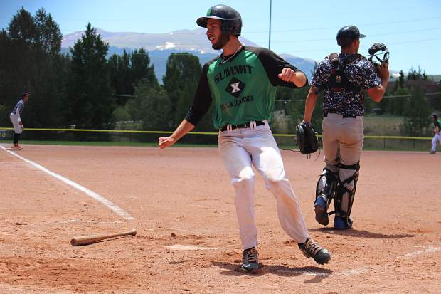Summit's John Anddrews out of Jefferson Community College crosses the plate in the first game of Thursday's doubleheader against the Grand Junction Rocky Mountain Oysters. Summit went on to win 7-5.
