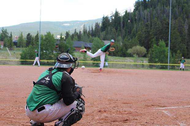 Catcher Gabe Trujillo awaits a warm-up pitch from Summit starter Ben Wiley between innings in Thursday's first game against the Grand Junction Rocky Mountain Oysters.