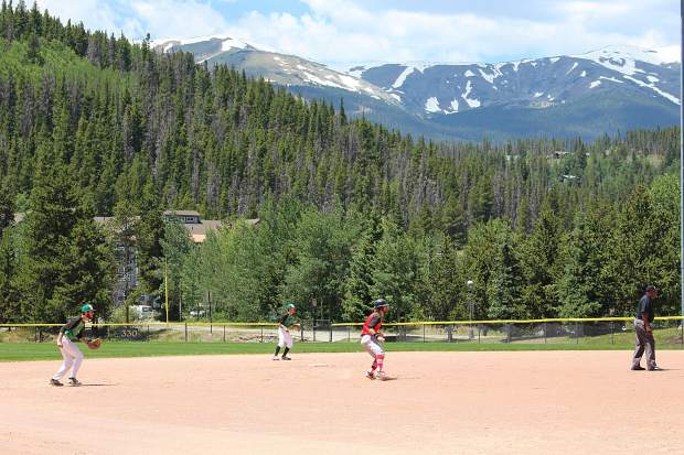 The Black Diamonds infield prepares for the play as a Steamboat player takes his lead off second during the first game of a doubleheader on the Fourth of July.