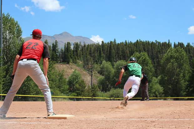 Summit's Andrew Ryals gets a jump and takes off for second in the first game of a Fourth of July doubleheader against the Steamboat Storm.