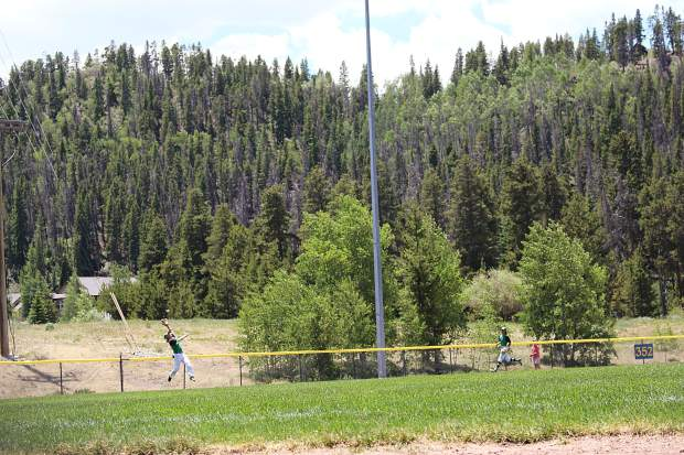Black Diamonds left fielder Andrew Ryals makes a leaping catch at the fence on the Fourth of July against the Steamboat Storm.