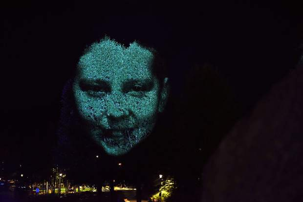 "The face of 12-year-old local dancer Zoe Gallup is projected on a tree in downtown Breckenridge as contemporary Australian artist Craig Walsh tests out a new public art installation titled ""Monuments"" ahead of the Breckenridge International Festival of Arts, which runs today through Aug. 20."