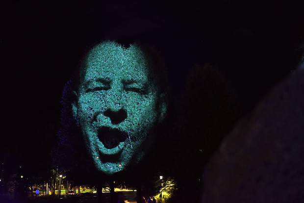 "The face of local biking enthusiast Jeff Westcott is projected on a tree in downtown Breckenridge as contemporary Australian artist Craig Walsh tests out a new public art instillation titled ""Monuments"" ahead of the Breckenridge International Festival of Arts, which runs today through Aug. 20."