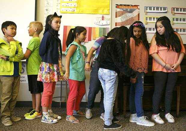 Silverthorne Elementary fifth-grade students line up to head to their next class during the first day of school on Thursday.