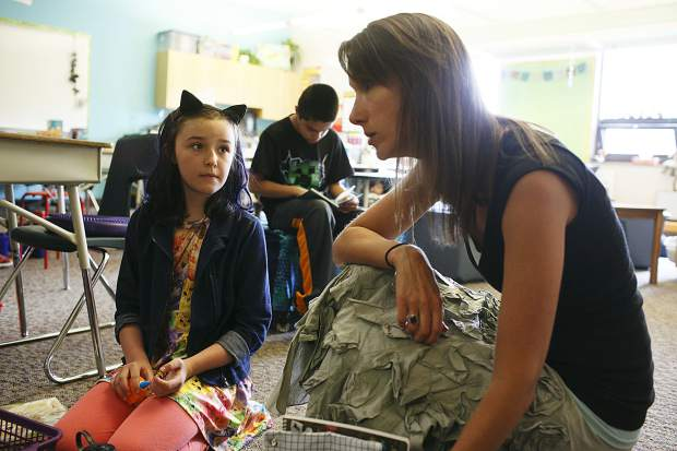 Silverthorne Elementary teacher Liz McFarland talks with students as Kyah Quam listens in.