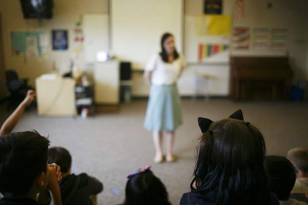 Silverthorne Elementary fifth-grade students listen to music teacher Chloe David, in background, during a brief class session Thursday during the first day of school.