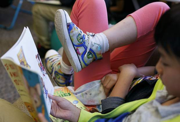 Fifth grader Kyah Quam's shoes give away her affection for cats to new peers in Liz McFarland's class at Silverthorne Elementary.