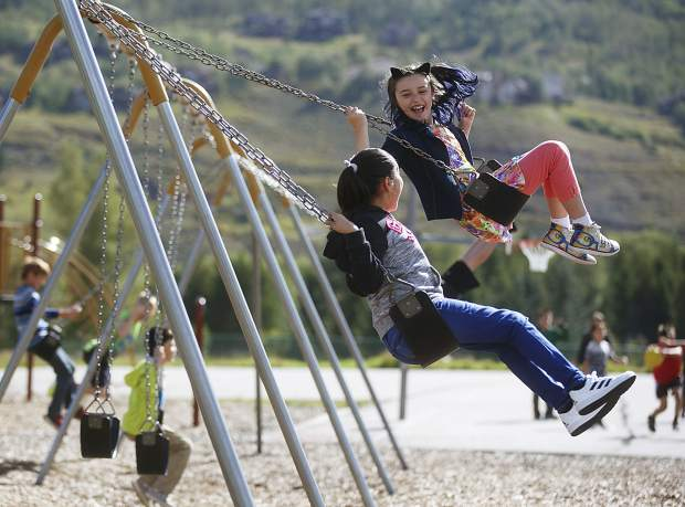 Kyah Quam enjoys swing set with her classmates Thursday, Aug. 24, at Silverthorne Elementary School during the first day.