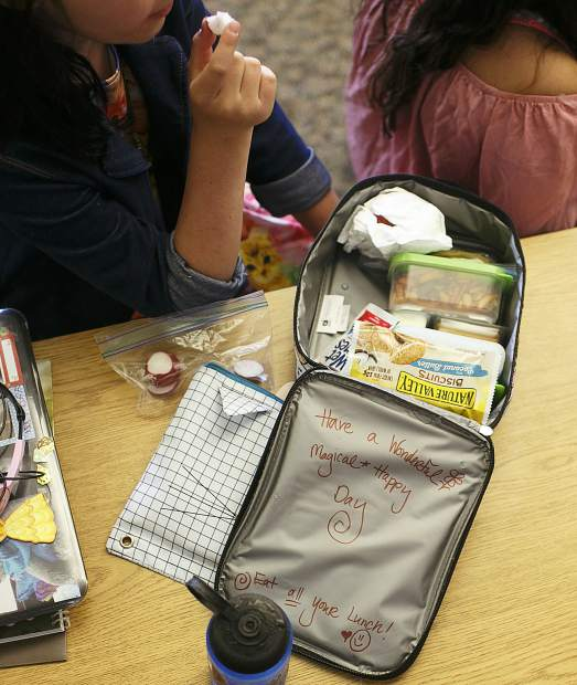 Snack time followed gym class Thursday morning at Silverthorne Elementary School for a class of fifth graders on their first day. Here, Wildernest resident Kyah Quam eats a sliced radish from her cat-themed lunch pail.