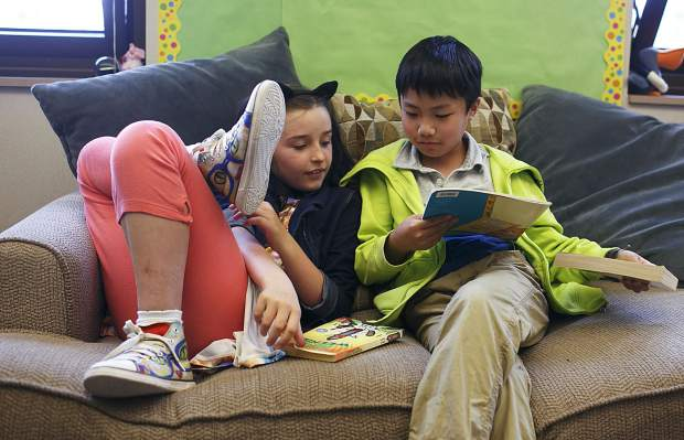 Silverthorne Elementary students Jesse Wiono, right, and Kyah Quam share a book Thursday, Aug. 24.