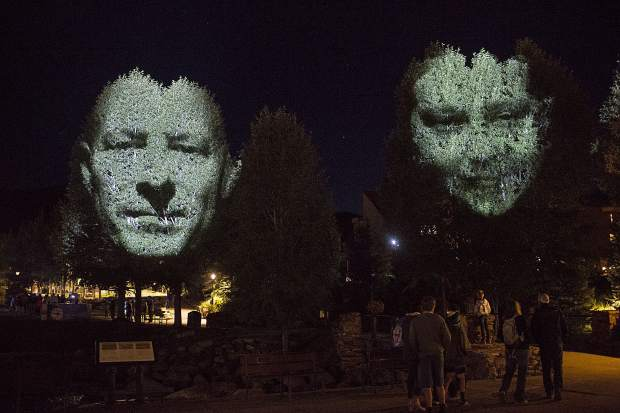 The Monuments, with light projected on a tree, on display at the Blue River Plaza in part of the Breckenridge International Festival of the Arts Wednesday, Aug. 16.