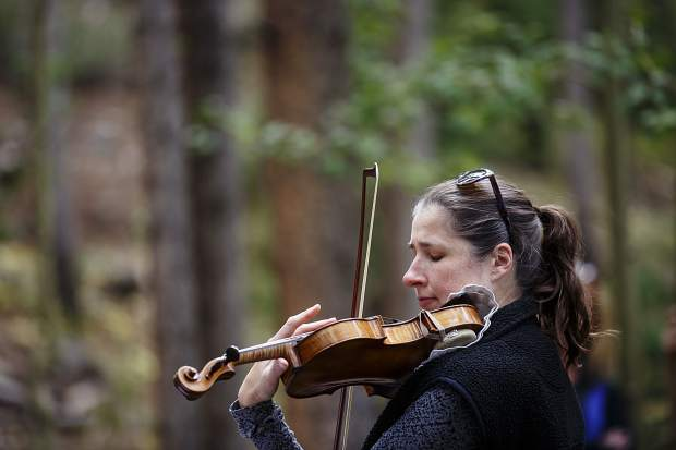 Kate Hatmaker perform along side of Illinois Creek Trail in part of Breckenridge International Art Festival's Trail Mix series Monday, Aug. 14, in Breckenridge.