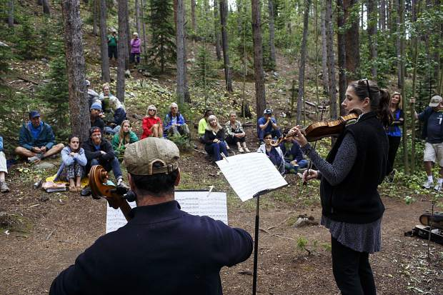 Kate Hatmaker, with violin, and Alex Greenbaum, with cello, perform in front of passing hikers on Illinois Creek Trail in part of Breckenridge International Art Festival's Trail Mix series Monday, Aug. 14, in Breckenridge.