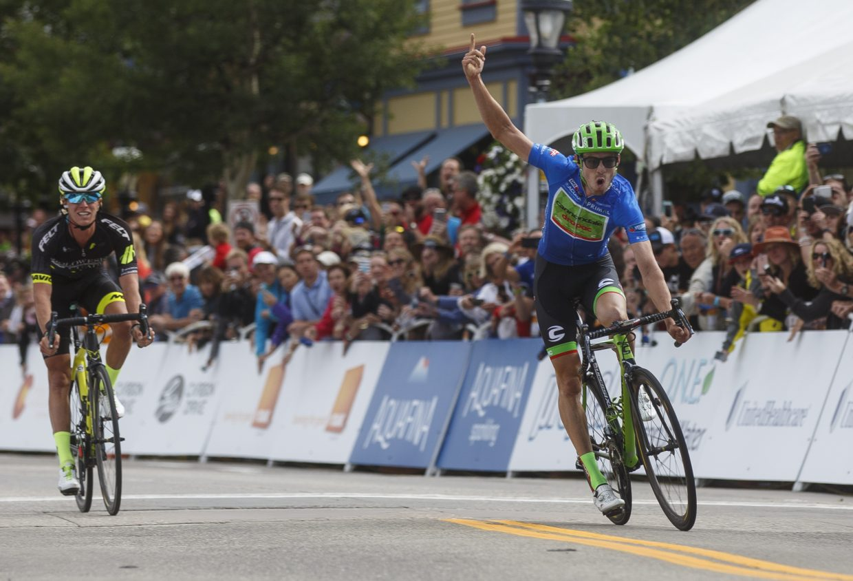 Alex Howes reacts after finishing in first overall of the Colorado Classic's Stage 2 race ahead of TJ Easenhart through Breckenridge's Main Street Friday, Aug. 11.