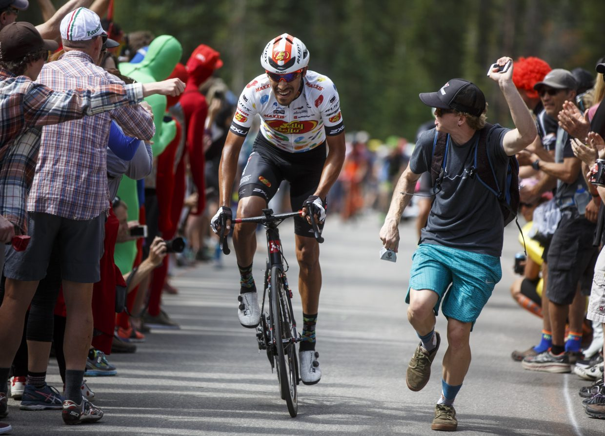 Summit County resident Skylar Drakos, right, cheers on a cyclists competing in the Colorado Classic's Stage 2 race on Boreas Pass Road Friday, Aug. 11 in Breckenridge.