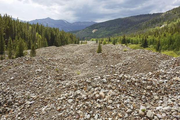The remnants of dredge mining on the Swan River is seen on Wednesday, Aug. 9, along French Gulch Road near Breckenridge.