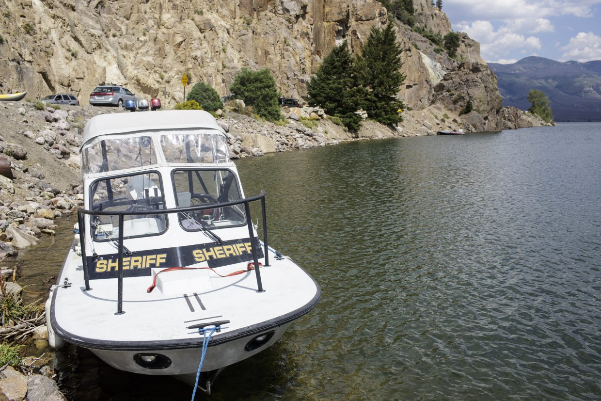 A Summit County Sheriff Office watercraft sits along shoreline of Green Mountain Reservoir following a body recovery Wednesday, Aug. 2, near Heeney.