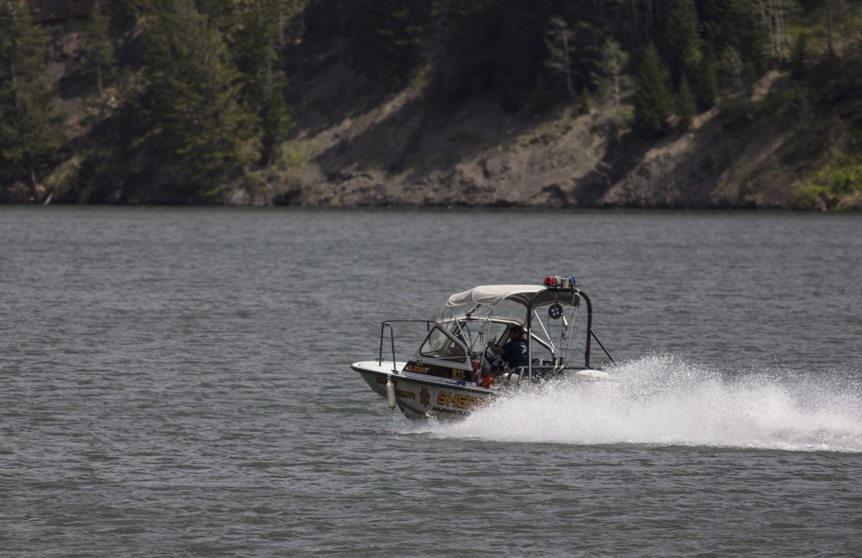 Summit County Sheriff Office deputies pilot their watercraft back to the marina at the Green Mountain Reservoir following a body recovery Wednesday, Aug. 2, near Heeney.