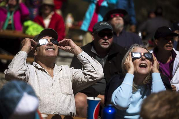 Silverthorne residents John and Jane Timmons view the solar eclipse through the solar goggles Monday, Aug. 21, at Arapahoe Basin.