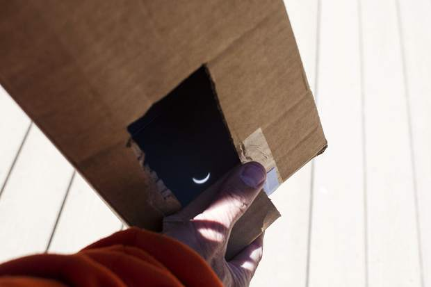 The solar eclipse visible from inside the homemade pinhole projector box made with a cardboard, aluminum foil, and tape Monday, Aug. 21, at Arapahoe Basin.