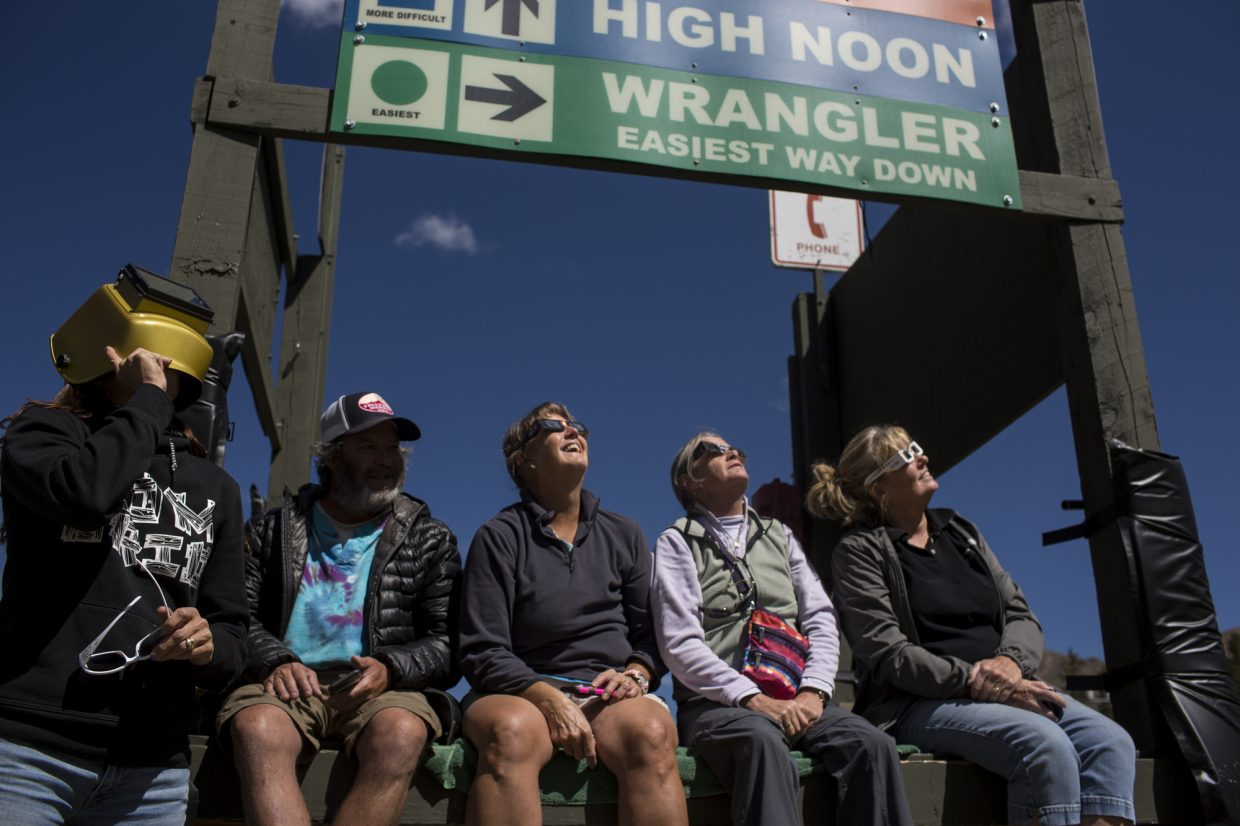 Summit County residents view the solar eclipse with their devices Monday, Aug. 21, at Arapahoe Basin.