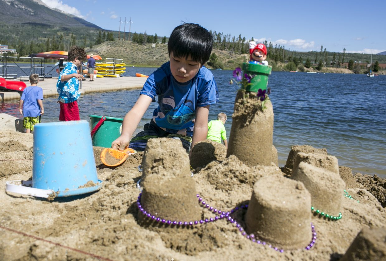 Jesse Wiono builds a sand castle for the 7th annual competition at the Frisco Marina Saturday, Aug. 12, in Frisco.
