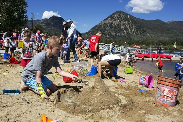 Young competitors build sandcastles for the seventh annual kids competition at the Frisco Marina, Saturday, in Frisco.