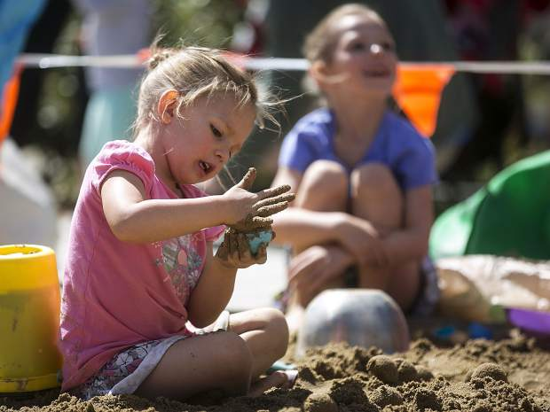 Jessalyn Basile, 3, shapes an object with sand for the castle in the seventh annual competition at the Frisco Marina, Saturday, in Frisco.