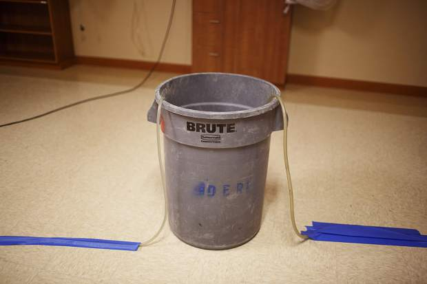 Buckets, connecting tubes, used to withdraw flooding waters in the Peak One Surgery Center Wednesday Aug. 9, in Frisco.