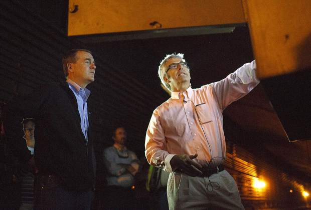 Sen. Michael Bennet, left, listens to Steve Havelson, an engineer for CDOT, while touring inside the Eisenhower Tunnel Wednesday, Aug. 23, on Loveland Pass.