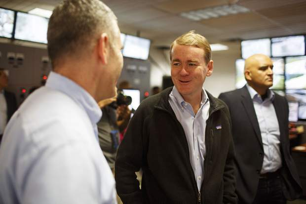 Sen. Michael Bennet chats with CDOT leaders and members of the I-70 coalition while touring inside the Eisenhower Tunnel Wednesday, Aug. 23, on Loveland Pass.