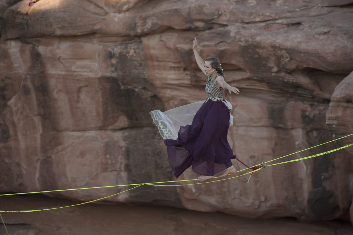 Purple walks the slackline  to the space net.