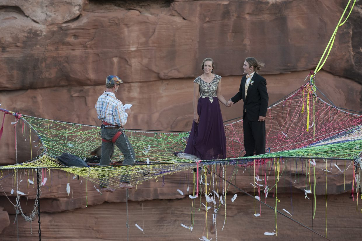 Friends look on as Mickey and Purple exchange vows on the space net.