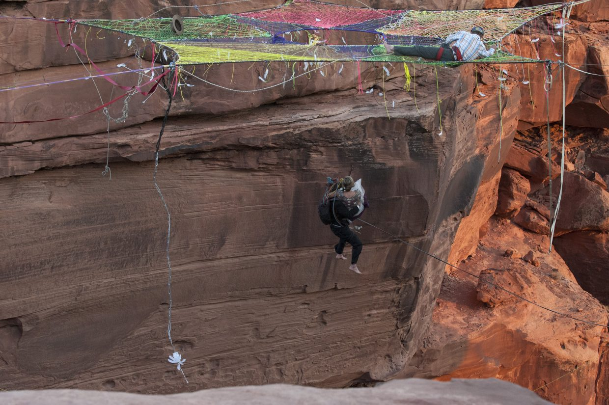 Mickey and Purple Wilson drop through the space net into the canyon on a rope swing.