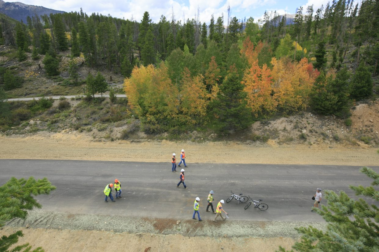 Bicyclists and construction crew members use the Dickey Connector Path, a temporary bike and pedestrian detour from the Blue Mountain Bikeway due to Iron Springs construction on Highway 9, south of Frisco  Thursday, Sept. 14. The connector path will remain in place until the construction crews complete the Blue Mountain Bikeway project.