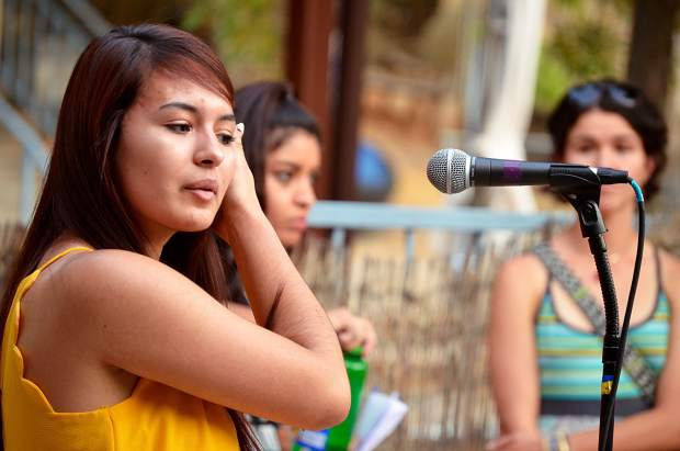 At a rally Tuesday evening in Glenwood Springs, Gabby Lopez, a local beneficiary of Deferred Action for Childhood Arrivals, tells a crowd of around 100 the story of how her parents brought her to the United States when she was only 6 months old and the threat she faces under DACA's revocation.