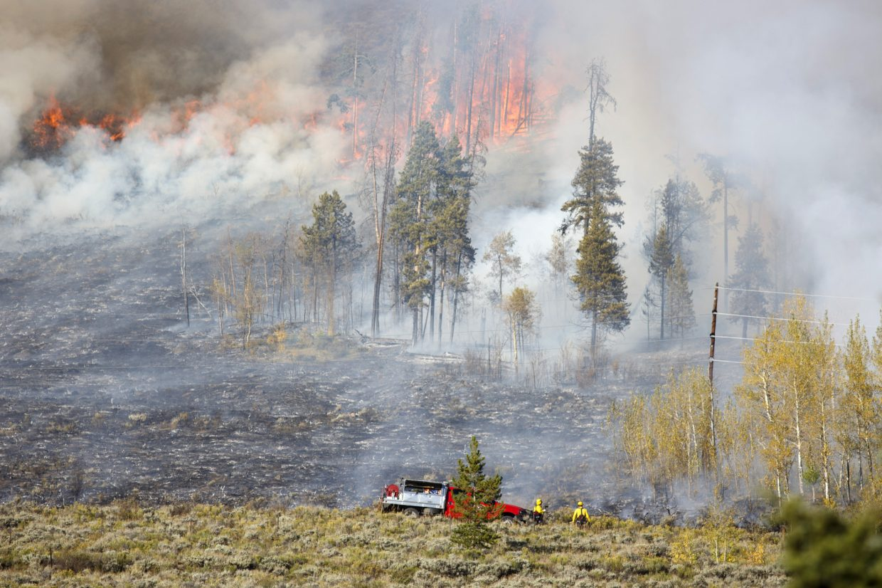 Wildland firefighters battle a fire along Tenderfoot Trail Monday, Sept. 18, in Dillon.