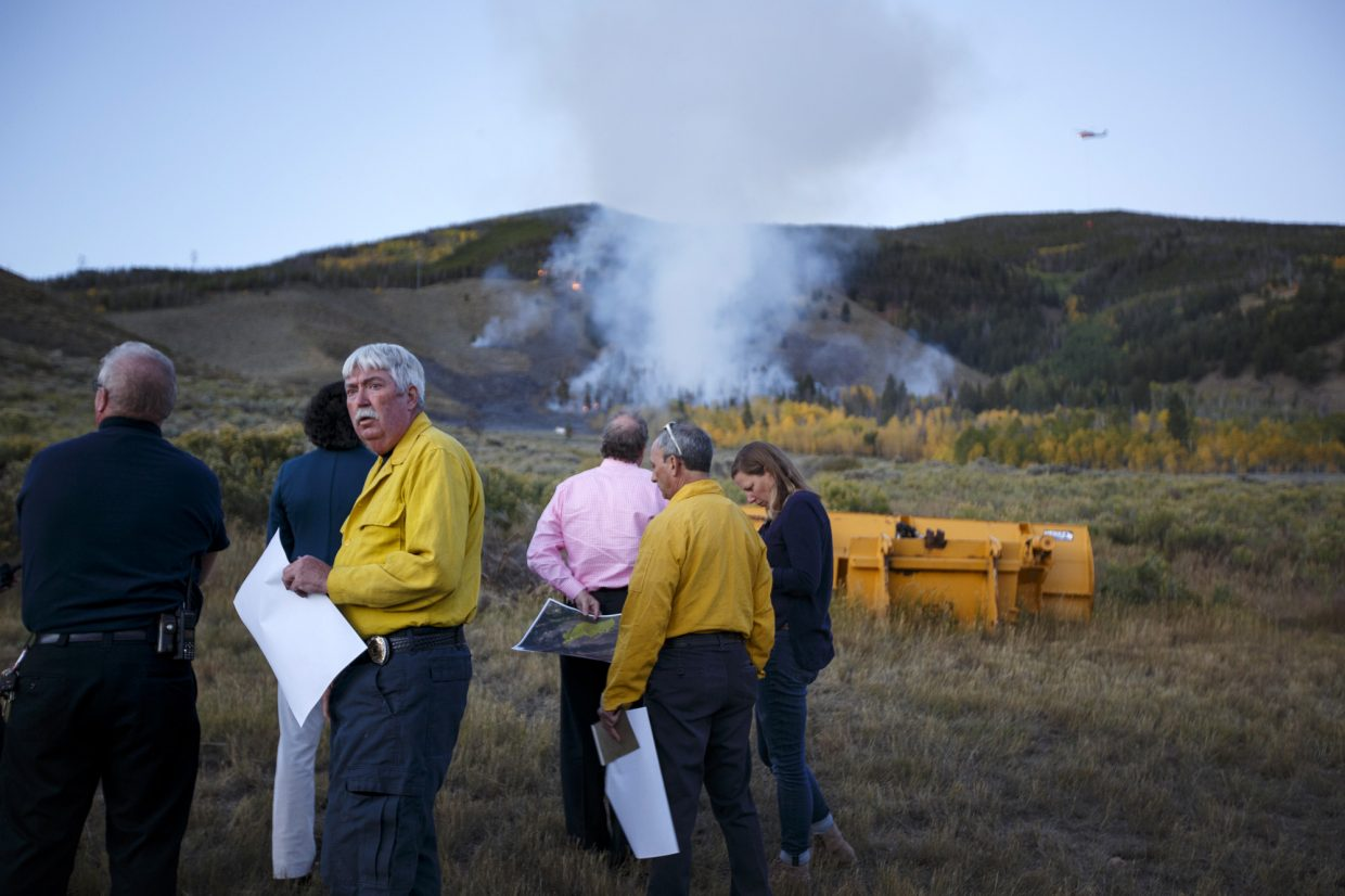 Fire officials discuss during a woodland fire Monday, Sept. 18, in Dillon.