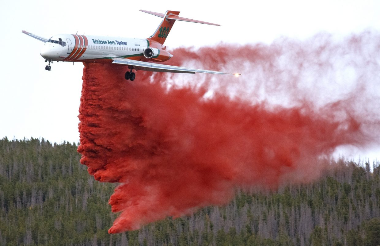 A wildland firefighter plan drops slurry on a fire along Tenderfoot Trail Monday, Sept. 18, in Dillon.