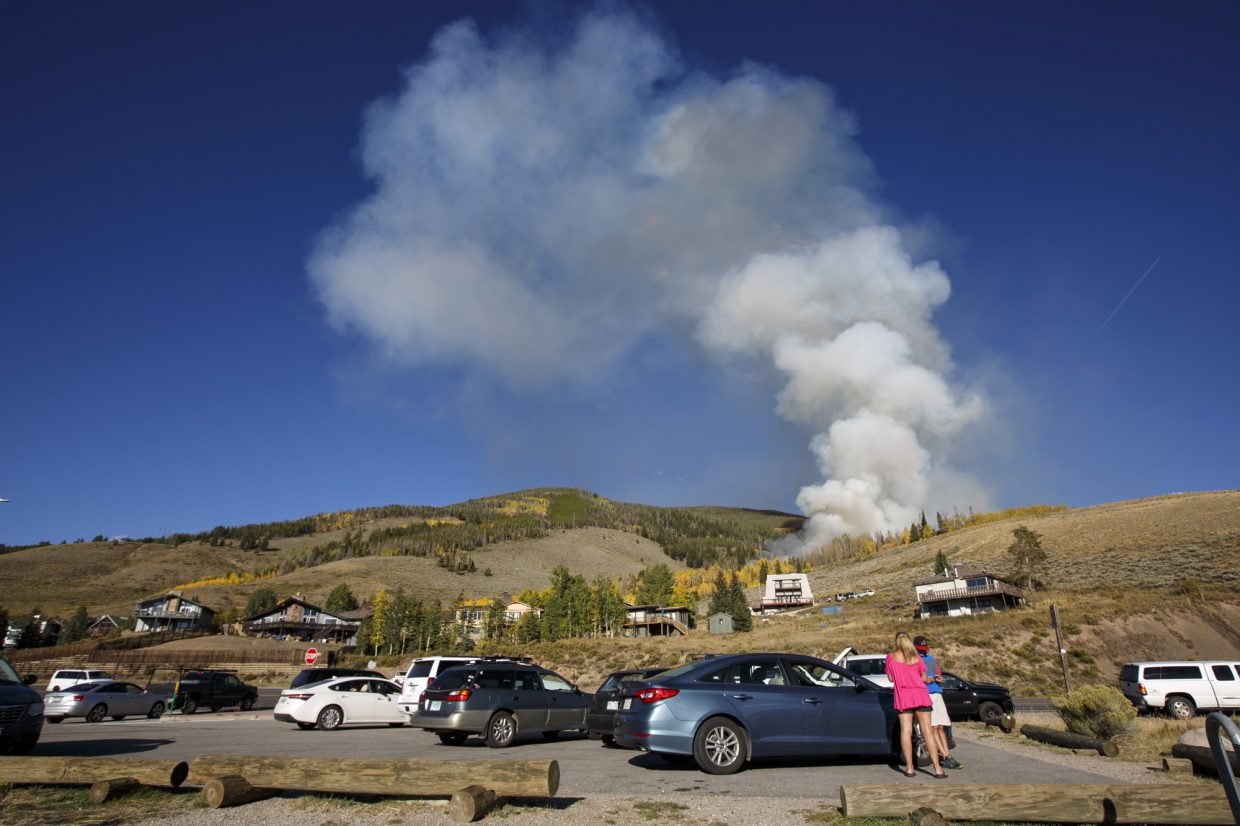 Passing motorists stop to take photos of a wildland fire near Highway 6 Monday, Sept. 18, in Dillon.