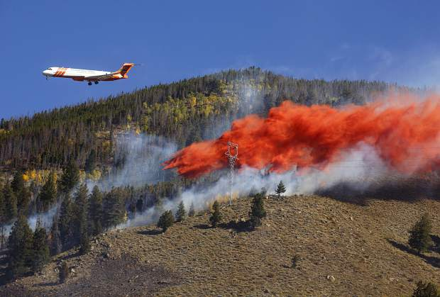 An air tanker dumps fire retardant slurry onto Tenderfoot2 Fire Tuesday, Sept. 19, in Dillon.