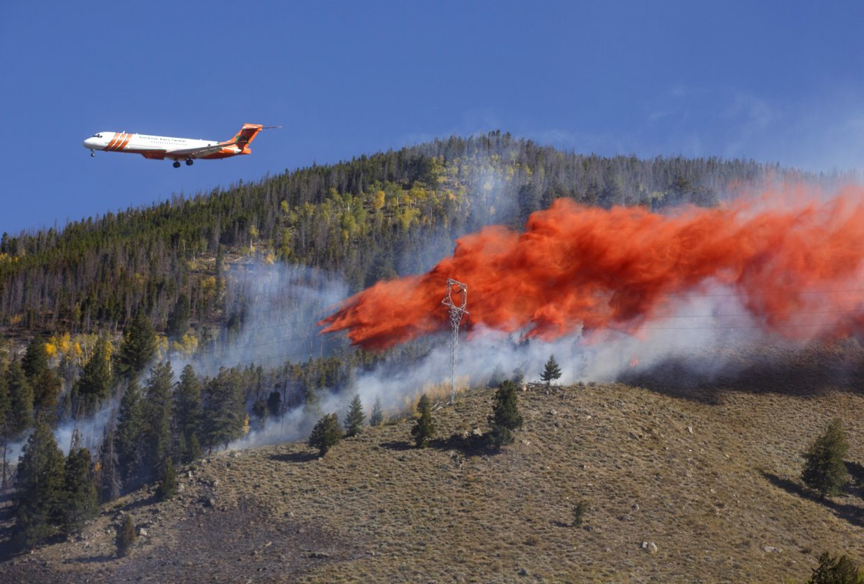 An air tanker dumps fire retardant slurry onto Tenderfoot 2 Fire Tuesday, Sept. 19, in Dillon.