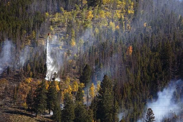 Water buckets dumped onto the Tenderfoot2 Fire Tuesday, Sept. 19, in Dillon.