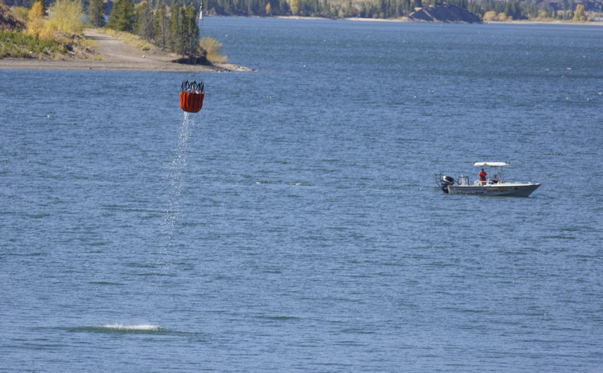 Water buckets refill by helicopter in the Dillon Reservoir to fight the Tenderfoot 2 Fire Tuesday, Sept. 19, in Dillon.