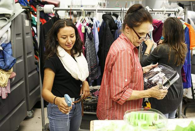 Ingrid Gaspar interacts with other employees at the Family & Intercultural Resource Center thrift store during her work shift Thursday, Sept. 7, in Dillon.